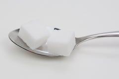 Cuillère à café de sucre images stock