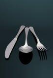 Cuillère argentée moderne, couteau, FO Image stock