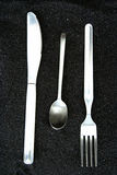 Cuillère, couteau et fourchette Images stock