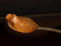 Cuillère de beurre d'arachide Photo libre de droits