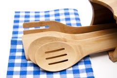 Cuillère de cuisinier avec la nappe Photo stock