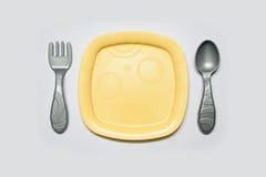 Cuillère et fourchette de Toy Dish Photo libre de droits