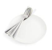 Cuillère, fourchette et couteau au-dessus du plat blanc photos libres de droits