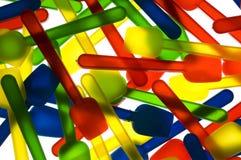 cuillères crèmes colorées de glace Photographie stock libre de droits