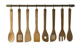 Cuillères en bois, spatules et une goupille d'isolement sur le dos de blanc Photos libres de droits