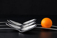 Cuillères et boules de golf Image libre de droits