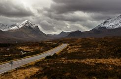 The Cuillin Hills. The A863 leading to the snow-covered Cuillin Hills on the Isle of Skye. A Storm is coming Stock Photo