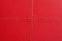 Cuir rouge avec le fond de couture de croix Image stock