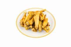 Cuisez les ailes à la friteuse de poulet Images stock