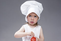 Cuisine and Cooking Concepts and Ideas. Portrait of Lovely Cute Caucasian Girl Posing as Cook. Stock Image