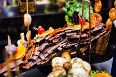 Cuisine Culinary Buffet Dinner Catering Dining Food Celebration Party Concept. Aubergine cooked on a grill, cut in long pieces and beautifully laid out on a stock photos