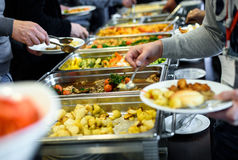 Cuisine Culinary Buffet Dinner Catering Dining Food Celebration. Party Concept. Group of people in all you can eat catering buffet food indoor in luxury stock images