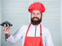 Cuisine culinary. man holds kitchen dish tray in restaurant. Healthy food cooking. Mature hipster with beard. Dieting stock image