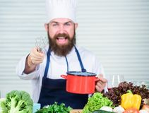 Cuisine culinary. Vitamin. Vegetarian salad with fresh vegetables. Healthy food cooking. Mature hipster with beard royalty free stock photo