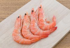 Cooked Prawns or Tiger Shrimps on Cutting Board. Cuisine and Food, Cooked Prawns or Tiger Shrimps on Wooden Cutting Board Stock Photo
