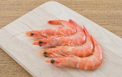 Cooked Prawns or Tiger Shrimps on Cutting Board. Cuisine and Food, Cooked Prawns or Tiger Shrimps on Wooden Cutting Board Royalty Free Stock Images