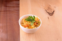 Cuisine - fried rice with meat on wooden background Stock Images
