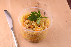 Cuisine - fried rice with meat on wooden background Stock Photography