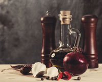 Cuisine still life with olive oil, spices and onion Stock Photo