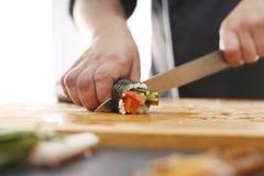 Cuisines of the world, Japanese sushi. Sushi master preparing sushi in Japanese restaurant stock photography