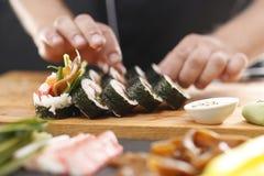 Cuisines of the world, Japanese sushi. Sushi master preparing sushi in Japanese restaurant royalty free stock photography