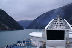 Cuising Tracy Arm Fjord. Tracy Arm Fjord of Alaska as seen from the deck of a large cruise ship navigating the narrow passageway to the glacier Royalty Free Stock Images