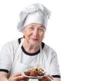 Cuisinière aînée de femme Photos libres de droits