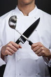 Cuisinier émotif avec le couteau et la fourchette Photos libres de droits