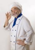Cuisinier attirant heureux Images stock