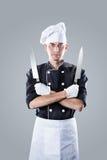 Cuisinier avec des couteaux rendu 3D et photo De haute résolution Photos stock