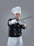 Cuisinier avec des couteaux rendu 3D et photo De haute résolution Images libres de droits