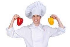 Cuisinier avec le poivre Photo stock