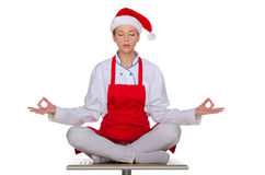 Cuisinier dans le chapeau de Santa Claus Photos stock