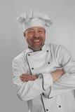 Cuisinier dans les rires blancs de chapeau photographie stock