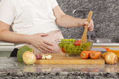 Cuisinier enceinte images stock