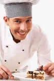 Cuisinier et gâteau Images stock