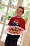 Cuisinier heureux de gosse Photographie stock libre de droits