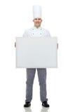 Cuisinier masculin heureux de chef tenant le grand conseil vide blanc images libres de droits