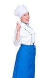 Cuisinier souriant de jeunes dirigeant le doigt Photos stock