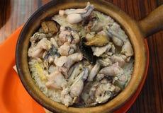 Cuisses de grenouille avec du riz Photographie stock