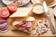 Cuisson d'un sandwich. Photo stock