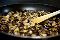 Cuisson de champignon de couche Photographie stock