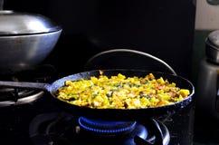 Cuisson des légumes jaunes Photo stock