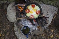 Cuisson du petit déjeuner Photos libres de droits