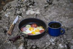 Cuisson du petit déjeuner Photo stock