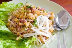 Cuisson du porc et du riz Photos libres de droits