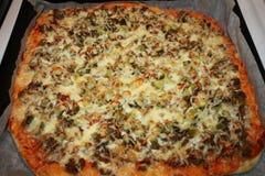 Cuisson, pizza Photographie stock libre de droits