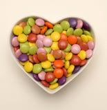 Cukierek w serce kształtującym pucharze Obraz Royalty Free
