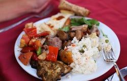 Cukierki, podśmietanie ryż na talerzu i wieprzowina i Zdjęcia Stock