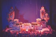Cukierki stół, nocy światło Obraz Royalty Free